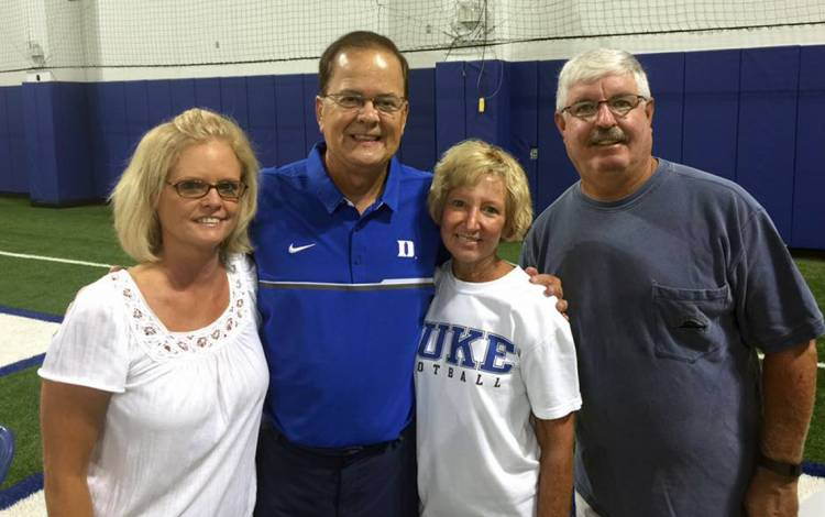 Donna Flamion, left, poses with Duke Football Coach David Cutcliffe, second from left, and friends. Photo courtesy of Donna Flamion.