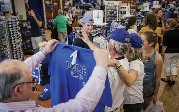 On commencement weekend 2019, students and their families flood into the University Store on West Campus. Photo by Alex Boerner.