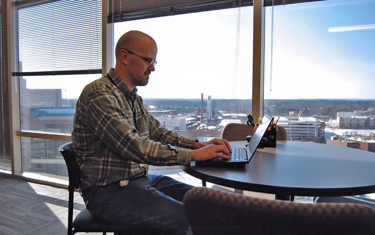 As one of the Duke Clinical Research Institute employees on the 10th floor of Durham Centre, Brad Conant enjoys expansive views of downtown Durham.