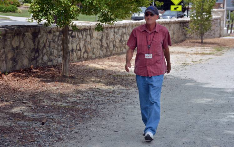 David Eck takes a walk on the path surrounding East Campus. Photo by Jonathan Black.