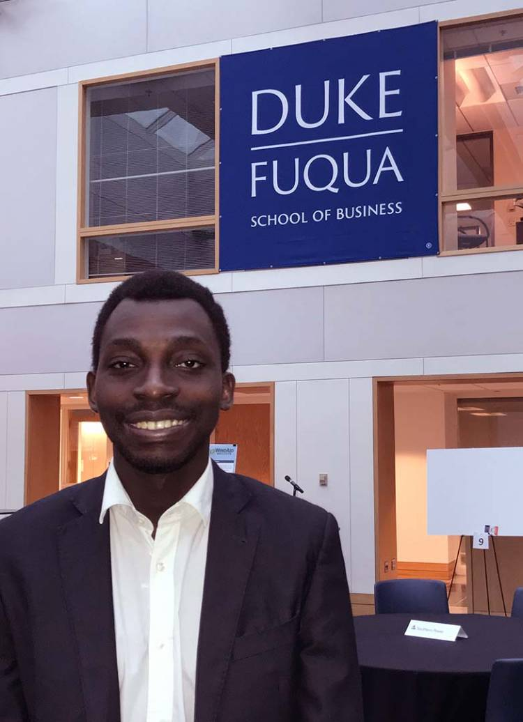 Jean Dominique Vidjanagni, the first student from Cote D'Ivoire to attend Duke, poses for a photo in the Fuqua School of Business.