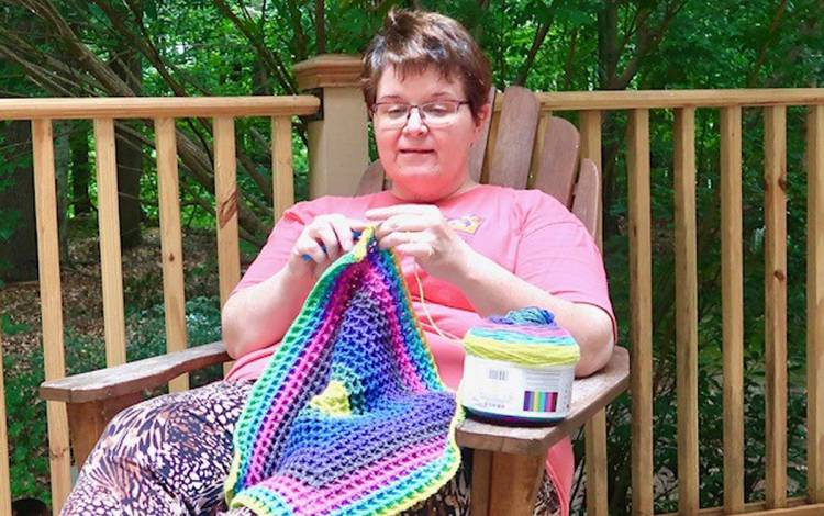 During the pandemic, Katrina Greely has found peace while crocheting on her back deck. Photo courtesy of Katrina Greely.