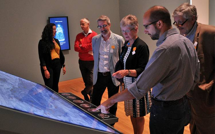 Wired! Lab members examine a previous exhibition they worked on at the Nasher Museum of Art. Photo courtesy of Kristin Huffman.