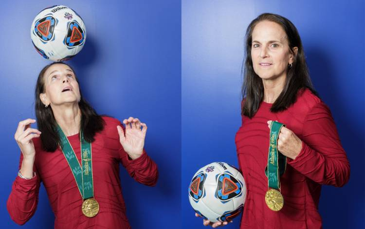 Carla Overbeck, assistant coach of the Duke women's soccer team, with her Olympic Gold Medal.
