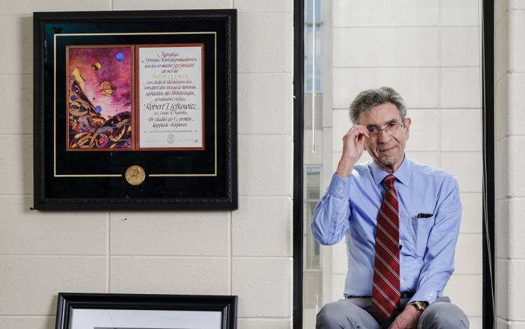 One of Robert Lefkowitz' three replica Nobel Prize medallions hangs in a frame on the wall of his office.