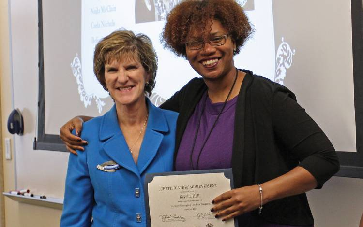 Marion Broome, left, dean of the Duke University School of Nursing, congratulates one of the first graduates of the school's Emerging Leaders Program, Keysha Hall, right.