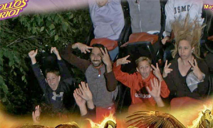 Jennifer Moore and her family ride a roller coaster.
