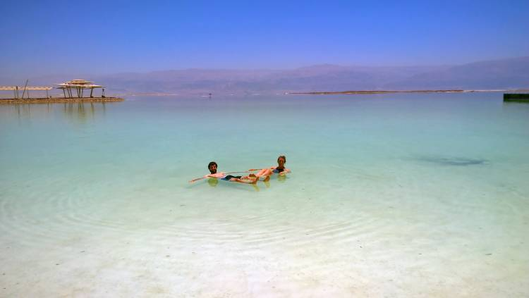 Jessica Robertson and her husband floating int he Dead Sea.