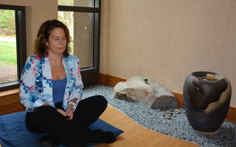 Jocelyn Weiss meditates in one of Duke Integrative Medicine's meditation rooms. Photo by Jonathan Black.