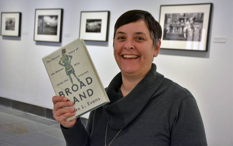 Jodi Psoter with the Low Maintenance Book Club's next selection, Broad Band. Photo by Jonathan Black.