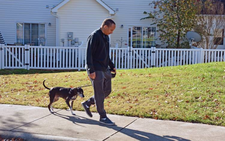 Jordan Hale walks with his dog, Champ. Photo by Jonathan Black.