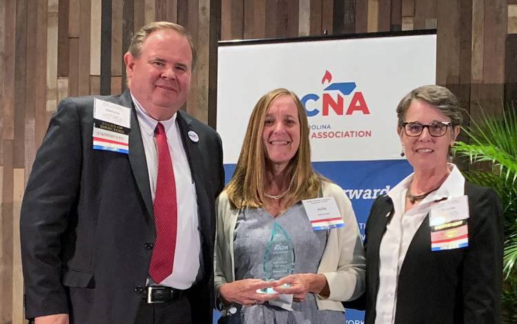 Flanked by officials from the North Carolina Nurses Association, Duke's Julia Gamble, center, was honored for her work last year. Photo courtesy of the North Carolina Nurses Association.