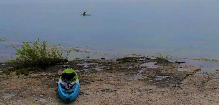 Sarah Hicks kayaks in Lake Erie after getting out of inpatient therapy for easting disorder treatment.