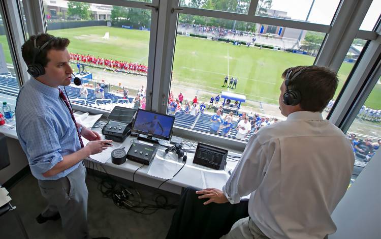 At left, Ryan Craig, left, and Jack Rowe provide play-by-play from Duke's lacrosse win against Boston University. Photo by Megan Mendenhall, Duke News & Communications.