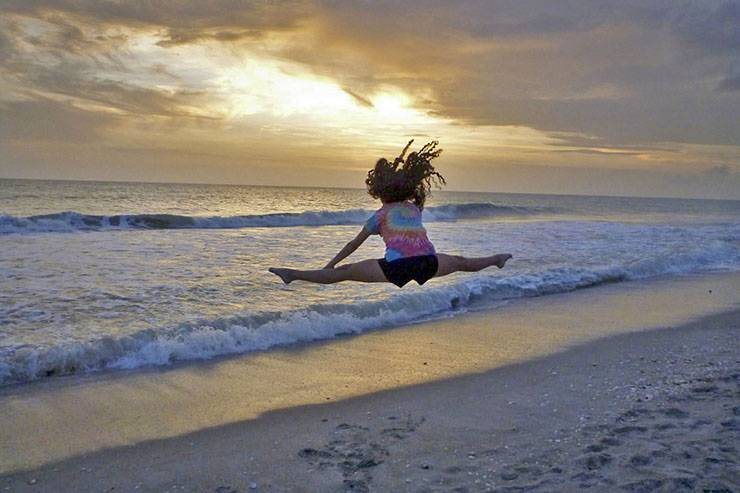 Jared Lazarus' daughter Caroline does leaping toe touches in front of a Florida sunset.