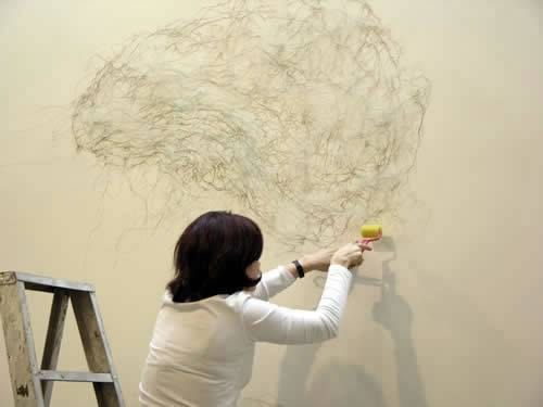 Libia Posada creates her medicine-based art.