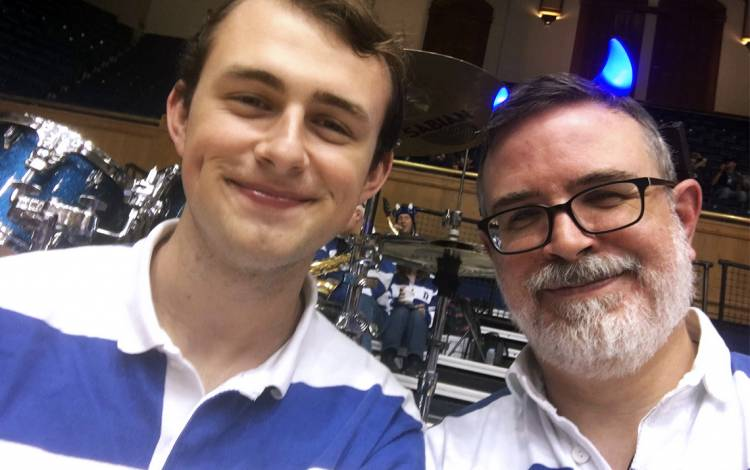 Thomas Hill, left, and his father Mark, right, have played together in the Duke Alumni Band. Photo courtesy of Mark Hill.