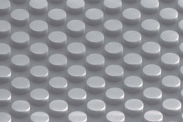 A dimpled surface with cylinders like the face of a Lego brick forms a non-metallic conductive material. The metamaterial absorbs electromagnetic energy without heating.