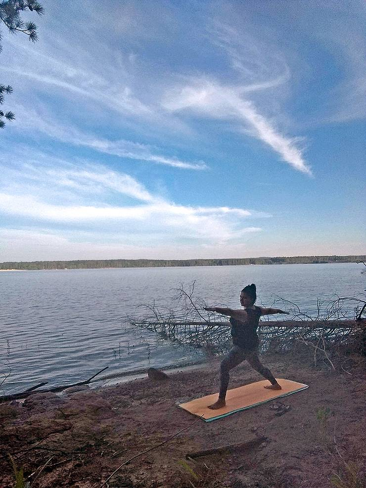 Monica Meza does sunrise yoga during a camping trip on the shores of Jordan Lake over the summer. Photo courtesy of Monica Meza.