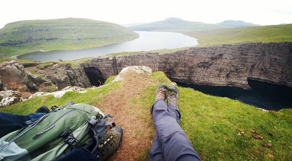 Morgan Trammel's view of the cliffs near a lake in the Faroe Islands.