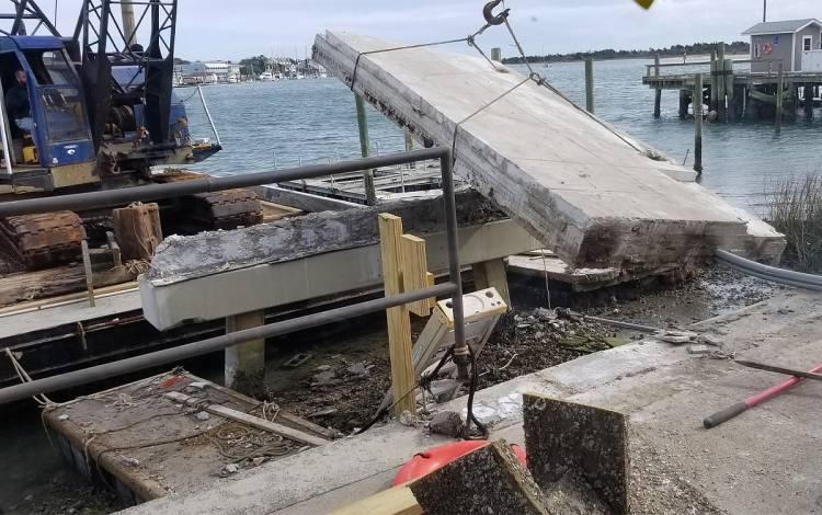 Construction crews install a new dock at the Duke Marine Lab that will better withstand storms.