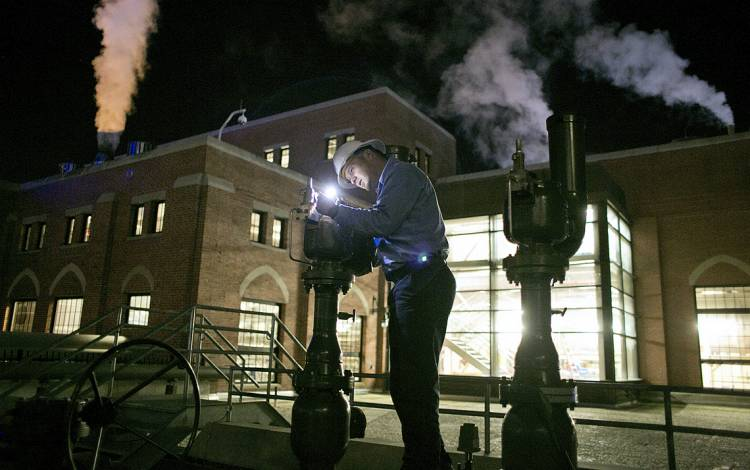 Utility operator Josh Speas, shown here at the West Campus Steam Plant, alternates between day and night shift every four months. Photo by Jared Lazarus.