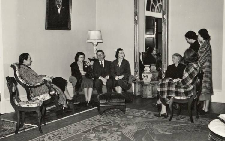 This photo from 1938 shows Mary Duke Biddle Trent Semans (second from left), Duke President William Preston Few (third from left) and Woman's College Dean Alice Baldwin (fourth from right) sitting in the Pink Parlor.
