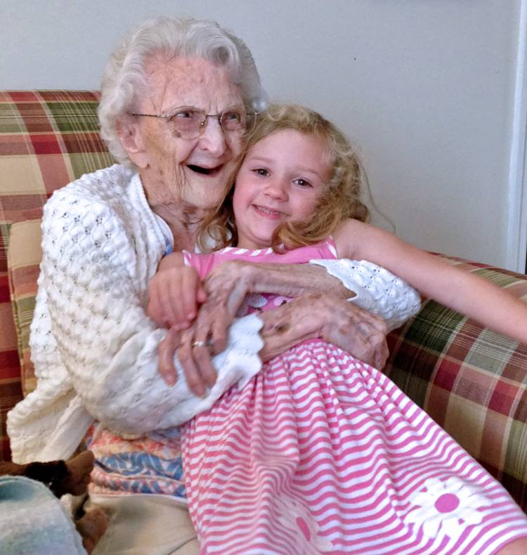 Joy Searles' granddaughter, Harper, sits on the lap of Searle's 108-year old Aunt Ethel.