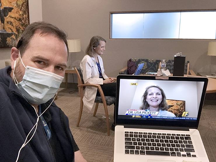 Shawn Rocco, left, assists Lisa Pickett, chief medical officer at Duke University Hospital, with setting up equipment to do live interviews.