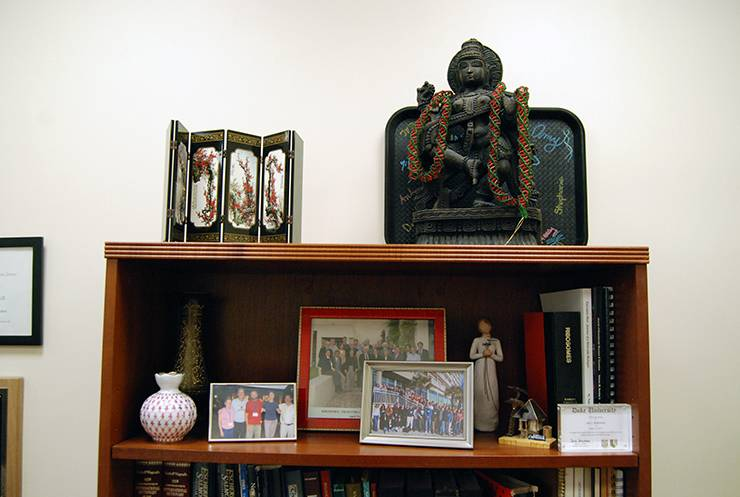 A shelf in Sue Jinks-Robertson's office holds gifts she's received from former students. Photo by Stephen Schramm.