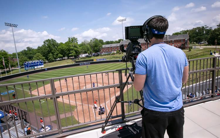 a camera captures the action as Duke's softball team faces Campbell University at home. Photo by Megan Mendenhall, Duke News & Communications.