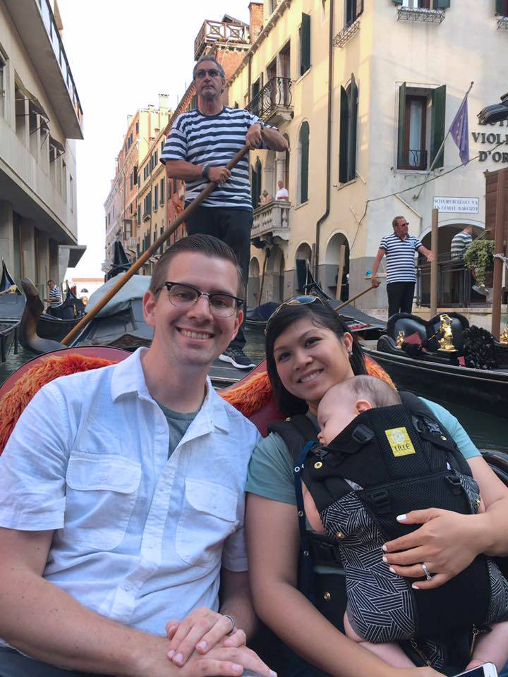 Tara Morgan rides a gondola in Venice, Italy with her husband and son.