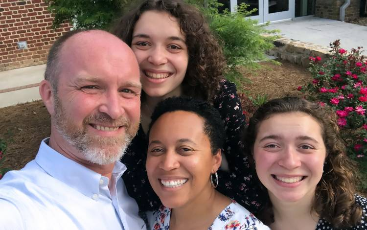 Tasha Curry-Corcoran, center, with her husband Daniel, left, and their two daughters. Photo courtesy of Tasha Curry-Corcoran.