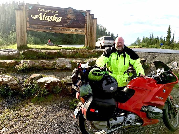 Tim Pennigar and his motorcycle as he enters Alaska.