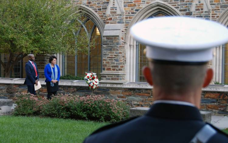 Duke's Antwan Lofton, left, and Sterly Wilder, right, place a wreath at the Duke Memorial Wall.