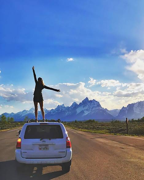 Katie Donahue on a car in Wyoming.