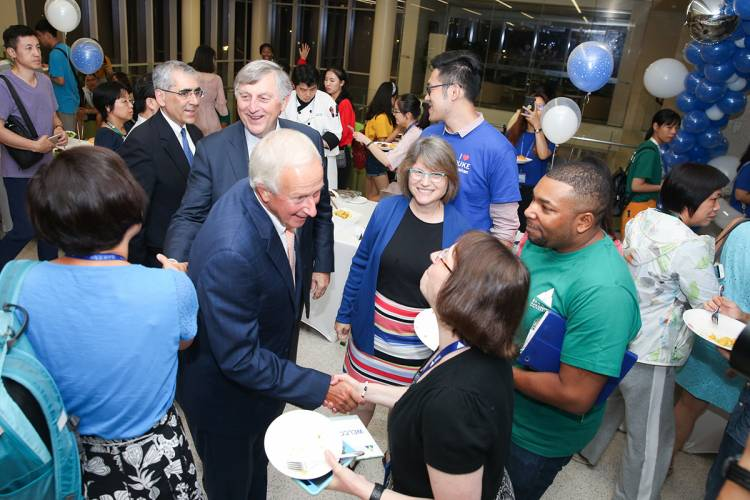 President Emeritus Richard H. Brodhead and current Provost Sally Kornbluth greet families and staff members at Duke Kunshan University.