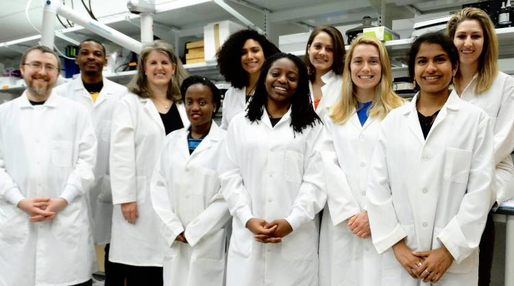 Jennifer West, third from left, stands with students in her lab.