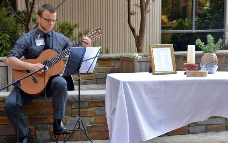 William Dawson performs at a recent memorial for employees.