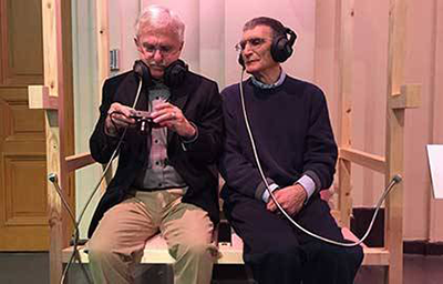 Paul Modrich and Aziz Sancar prepare for an interview during Nobel Prize week in Sweden.