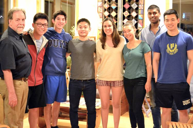 Economist Charles Becker led a dinner with Duke students in March.
