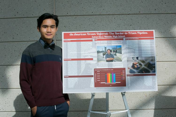 Student presents poster session on summer research institute