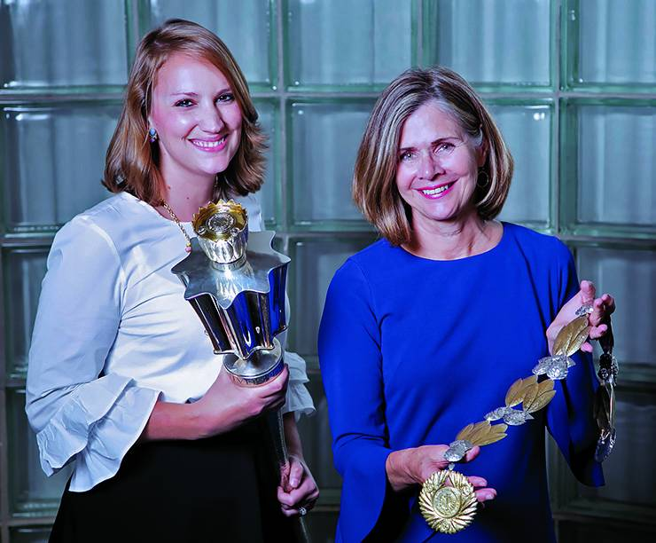Kaitlin Briggs, left, and Terry Chambliss, right, of the Office of Special Events and University Ceremonies hold the Duke University mace and chain of office.