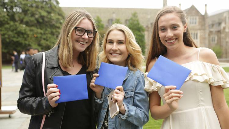 Below: Students from the Class of 2017 hold their letters of advice from Duke alumni. Photo by Julie Schoonmaker
