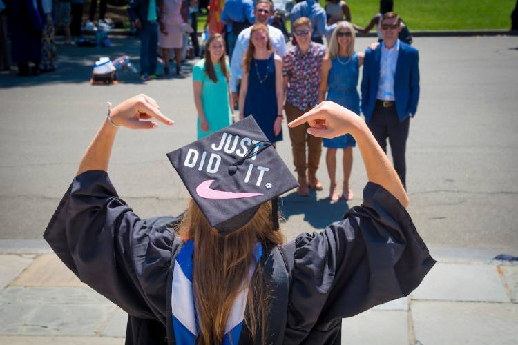 Student celebrates commencement, 2017. Photo by Duke Photography