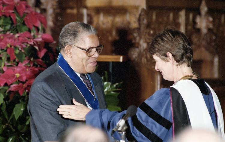 Samuel Dubois Cook receives the University Medal from then-President Nannerl O. Keohane in 1993. Photo by Duke Photography