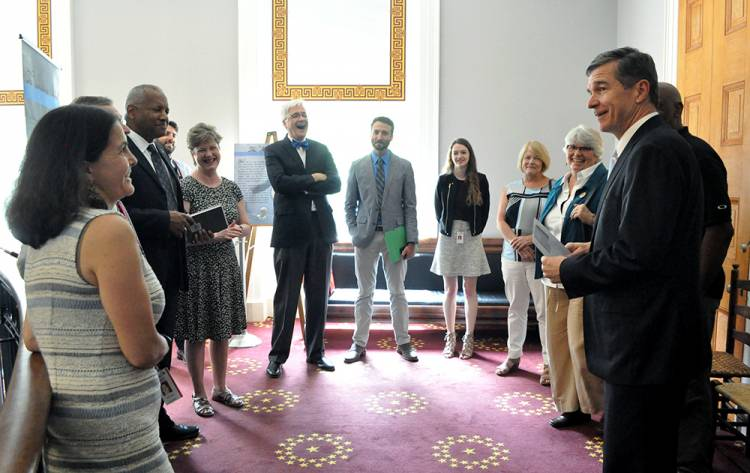 Gov. Roy Cooper and staff meet with the Duke delegation outside the Old Senate Chamber. Photo by April Dudash
