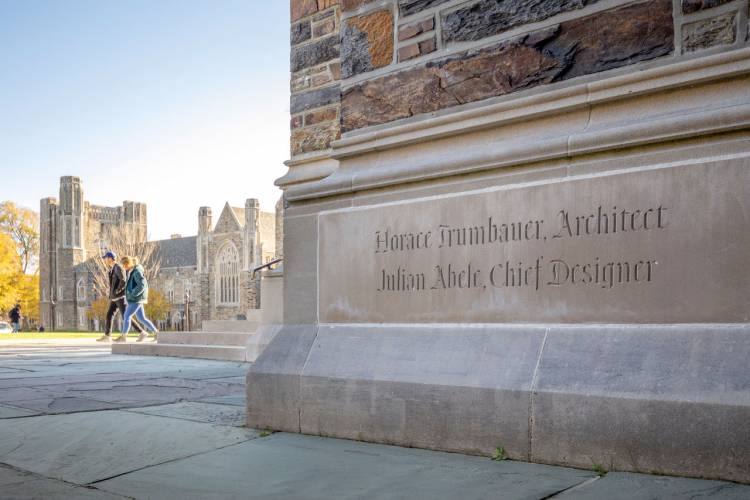 The Duke Chapel cornerstone commemorating Trumbauer and Abele. It faces the Divinity School. Photo by William Snead.