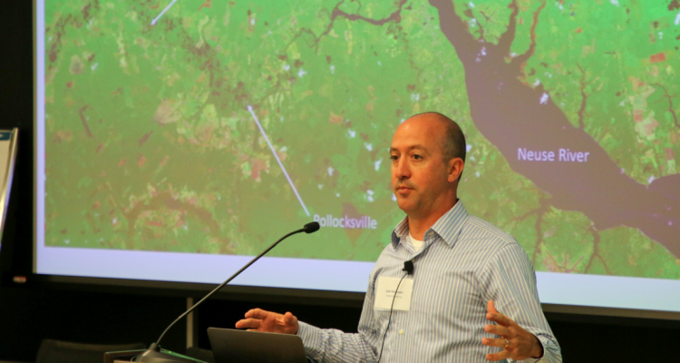 Lee Ferguson speaks about post-hurricane flooding and toxins at the Coming Storm conference