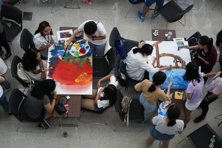 DKU students engage in a painting activity Wednesday at Duke Kunshan University.